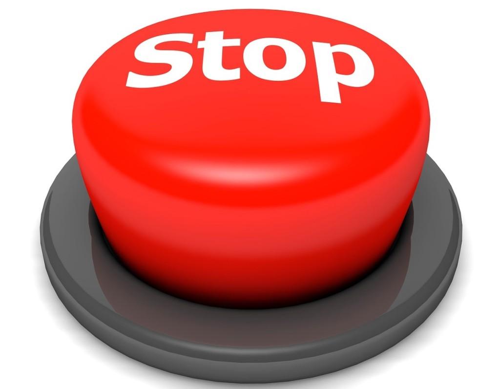 """En röd stoppknapp som står för """"handla med stopp"""""""